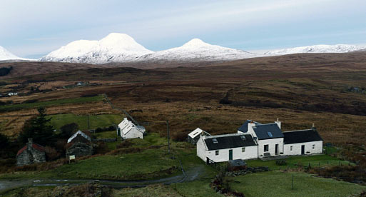 The former Paupers Houses at Ardfernal and Paps of Jura