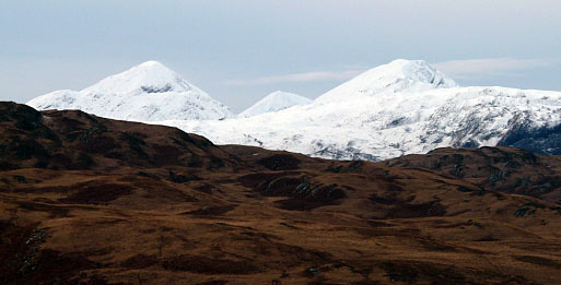 The White Paps contrasting with the brown mountains